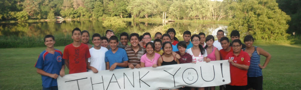 "San Miguel students holding a ""thank you"" banner"