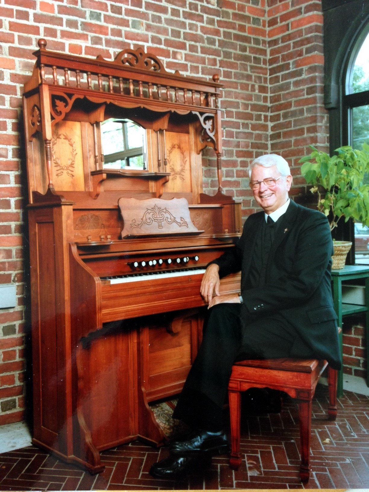 Brother Laurence at his piano in 1990.